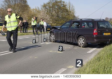 Bovenkarspel, the Netherlands - May 5, 2016: The traffic police do a thorough investigation Following an Accident Involving several at cars, s were bettrokken. and the road for a few hours was Deposited for safety.