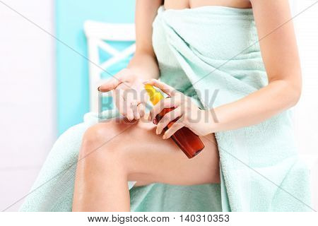 Skin care. Woman after bath rub skin with oil to the body