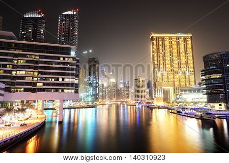 DUBAI UAE - SEPTEMBER 8: The night illumination of Dubai Marina on September 8 2013 in Dubai UAE. It is an artificial canal city built along a two mile (3 km) stretch of Persian Gulf shoreline.