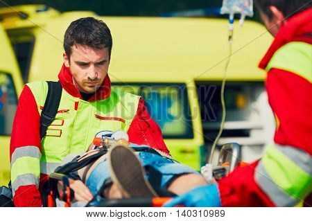 Team of rescuers (paramedic and doctor) preparing the patient after resuscitation for transport to the hospital.