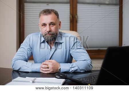 Portrait Of Solid Middle-aged Businessman.