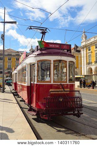 Lisbon, Portugal - March 06, 2016: Vintage Tourist Sightseeing  Tram on the Praca do Comercio  Lisbon Portugal.