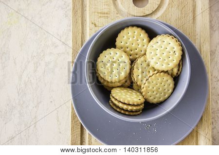 wheat sandwich cookies with chocolate filling cream round shape on wooden board top view left space for text available