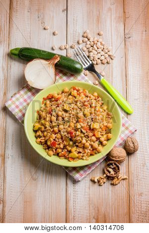 barley risotto with zucchinis chickpeas nuts and tomatoes