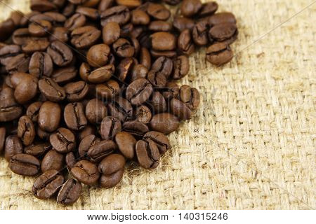 Closeup of coffee beans on sacking