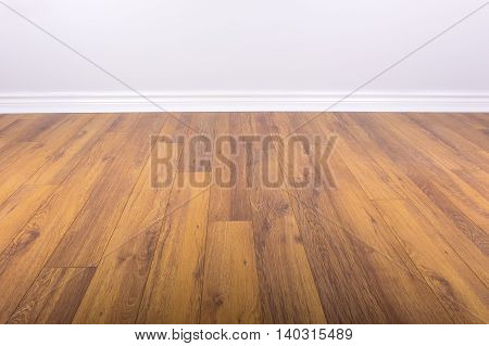 New Laminated Floor in a Room With Freshly Painted Wall