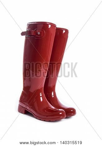 Women's Red Shiny Rubber Boots Isolated on White