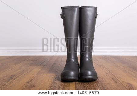 Men's New Grey Rubber Boots on Laminated Floor