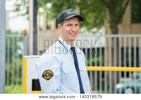 Portrait Of A Happy Young Male Security Guard