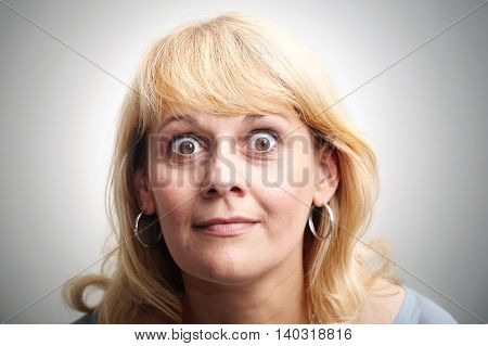 Close up portrait woman with big eyes looking at camera