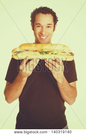 Isolated hungry man holding sandwich