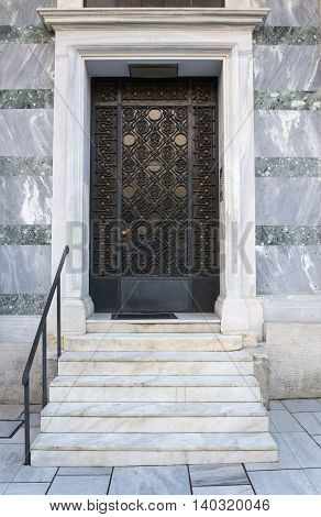 front door with marble steps finished with granite tiles