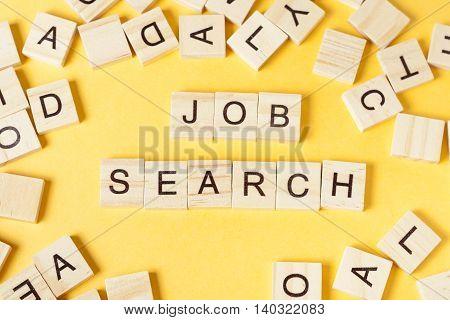 Job search word written on wood block. Wooden ABC.