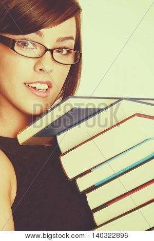 Pretty girl carrying school books