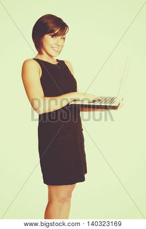 Smiling isolated woman holding laptop