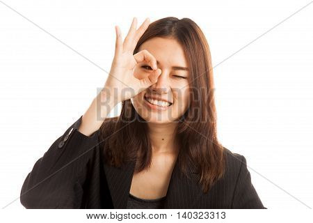 Beautiful Young Asian Woman Show Ok Sign Over Her Eye.