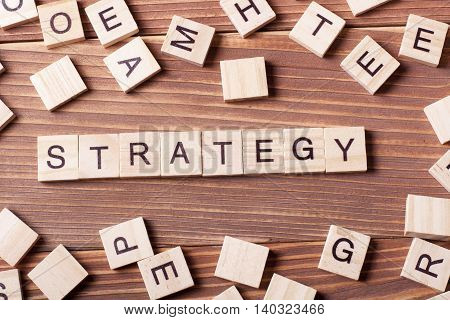 Strategy word on wooden cubes, sucess in business concept.