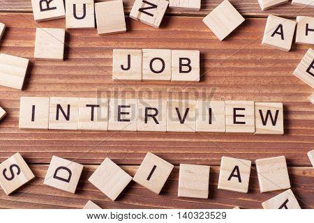 Job Interview word written on wood block. Wooden Abc