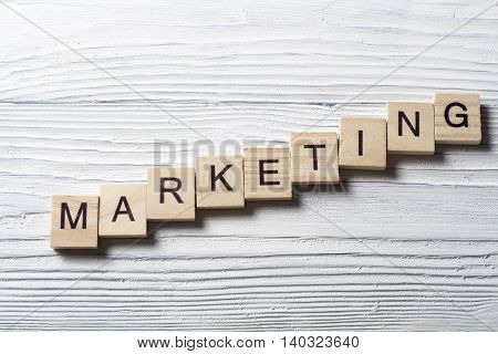 Marketing word write wooden cube on table.