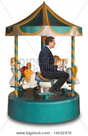 Businessman sitting on a small merry-g0-round ride on a white background