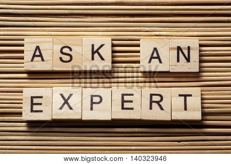 Ask an EXPERT text on wooden cubes. Wood abc