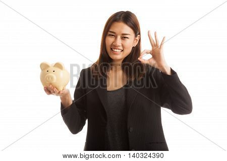 Asian Business Woman Show Ok  With Pig Coin Bank.