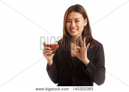 Young Asian Business Woman Show Ok With Tomato Juice.