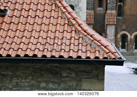 The traditional red-tiled roofs in the Prague