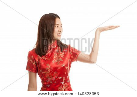 Asian Girl In Chinese Cheongsam Dress With  Blank Space On Her Hand.