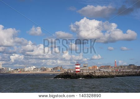 View on the entrance of the Harbour of Scheveningen the Netherlands with a Pier and Lighthouse