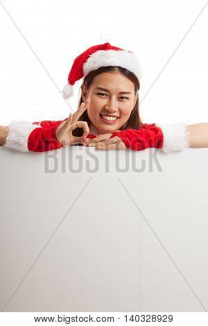 Asian Christmas Santa Claus Girl Show Ok With Blank Sign.