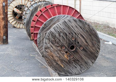 Large metal and wood spools for utility cable