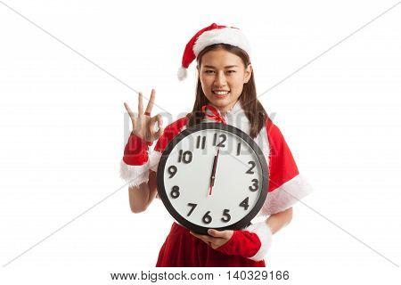 Asian Christmas Santa Claus Girl Show Ok And Clock At Midnight.
