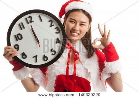 Asian Christmas Santa Claus Girl  Show Ok With Clock At Midnight.