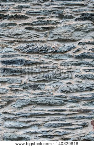 Gray Stacked Stones with Plaster Vertical background image