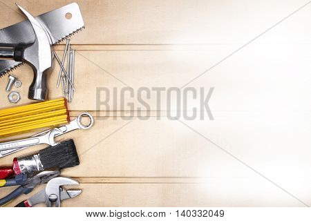 Assorted work tools on wood. Copy space