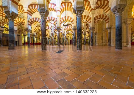 Cordoba, Andalusia, Spain - April 20, 2016: columns inside the Great Mosque Cathedral of the city of Cordoba.