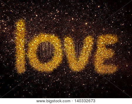 gold glitter abstract background with word LOVE