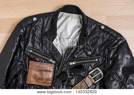 Men casual trendy fashion with Black jacket and accessories on wooden table still life style