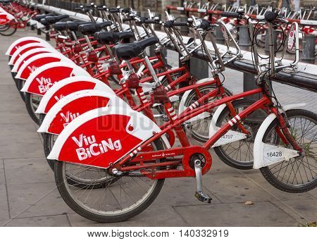 BARCELONA SPAIN - JULY 11 2016: Bicycles on a street of Barcelona. Bicing is the name of a bicycle sharing system in Barcelona inaugurated on March 22 2007.