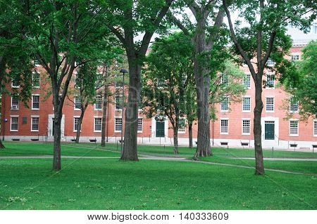 Harvard University Campus, ancient brick building and lawn in spring