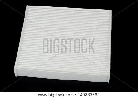 car cabin air filter isolated on black ground