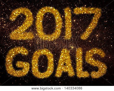 gold glitter abstract background with word 2017 goals