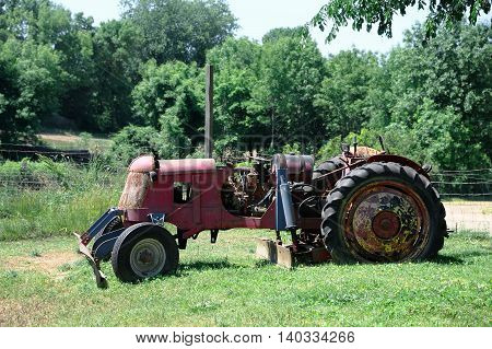 abandoned old tractor in the farm for design