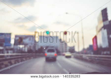 Blur Background : See Through Window Of Car On High Way Road In Evening With Traffic Light,abstract