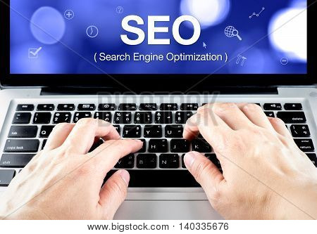 Search Engine Optimization (seo) Word On Notebook Screen With Hand Type On Keyboard, Seo Business Co