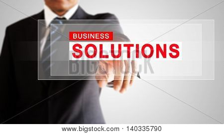 Businessman hand pressing on business solution screen