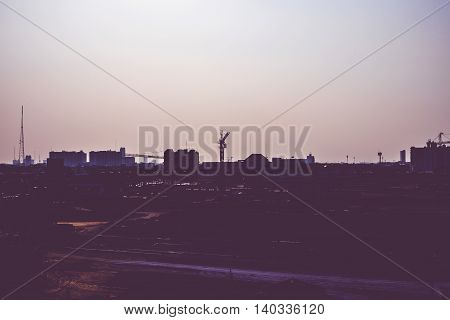 Vintage Filter :silhouette Of Landscape Sunset Scene With City Building
