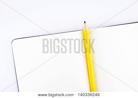 Top View Ofopen Notebook And Yellow Pencil With Wish List Topic On Table,template Mock Up For Adding