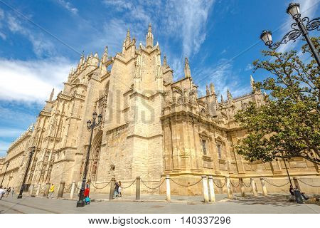 Seville, Andalusia, Spain - April 18, 2016: the side facade of Seville Cathedral a popular landmak.